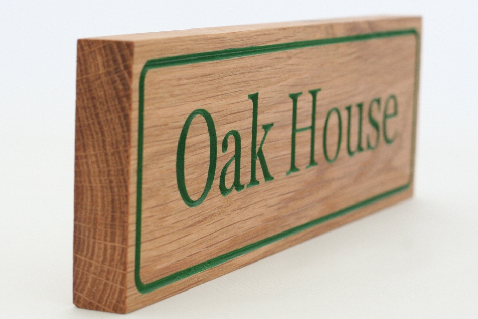 A sign for Oak House [1585]